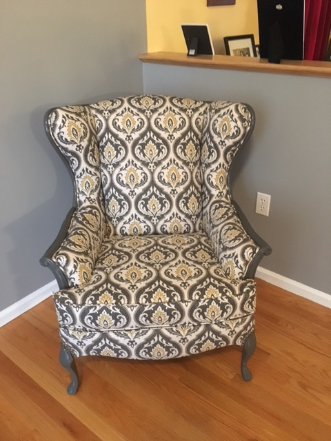 Traditional chair reupholstered by Locatelli-Smith Interiors