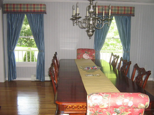 Upholstered parsons chairs, drapes, custom cornices
